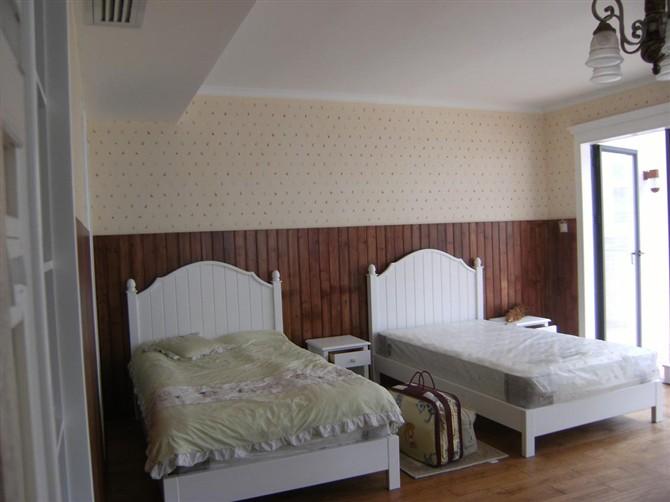 酒店卧室瓷砖墙裙装修效果图